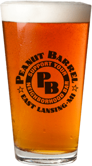 A glass of beer with the Peanut Barrel logo