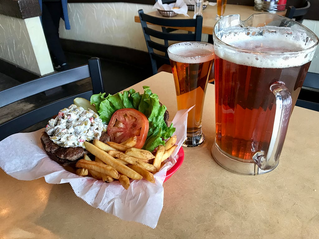 Olive burger with a pitcher of beer